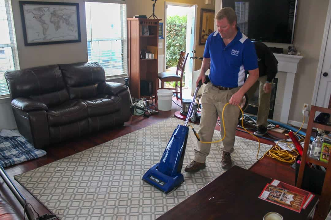 Matt Lashway, owner of Whitehall Carpet Cleaners, cleaning an area rug
