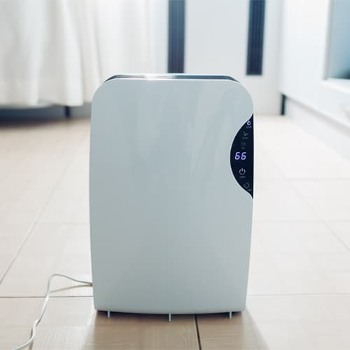 A dehumidifier is a device that draws moisture out of the air. A fan in the dehumidifier pulls air from the surrounding area into the unit.