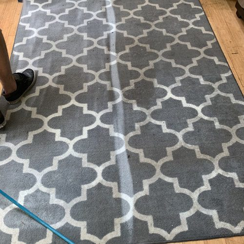 How do I clean my large area rug?